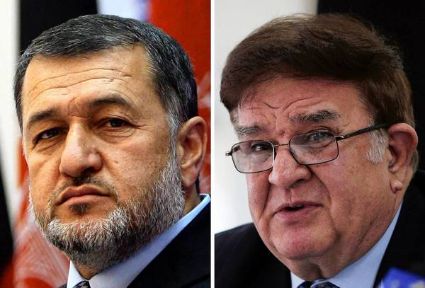 Afghan Interior Minister Bismullah Khan Mohammadi, left, and Defense Minister Gen. Abdul Rahim Wardak received no-confidence votes from the parliament in a blow to President Hamid Karzai's administration.