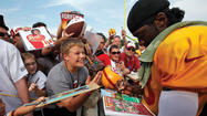 The loud ovation as Robert Griffin III walked from the Washington Redskins' practice facility down to the field is something he's gotten used to. It was just a bit louder on Saturday.