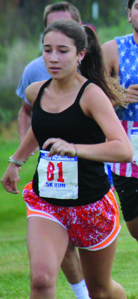 Sarah Crowley, the daughter of a former Danville runner, was the top female finisher Saturday at Coach Plummers 5K Run