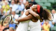 Williams sisters take gold