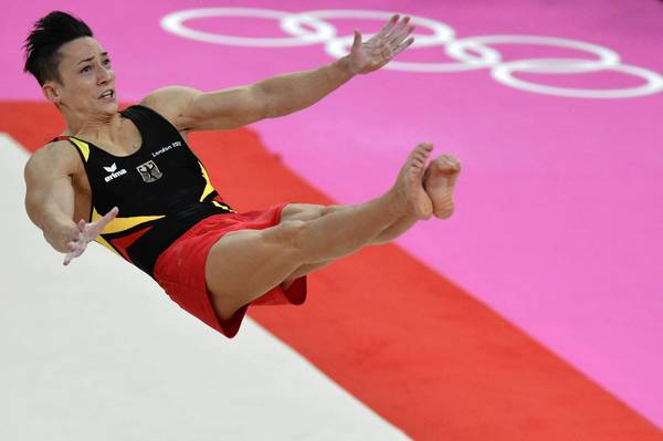 Germany's gymnast Marcel Nguyen competes in the men's floor exercise final.