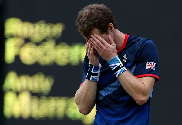 Andy Murray of Britain reacts after clinching victory over Switzerland's Roger Federer in the gold-medal men's singles tennis match on Sunday in London.