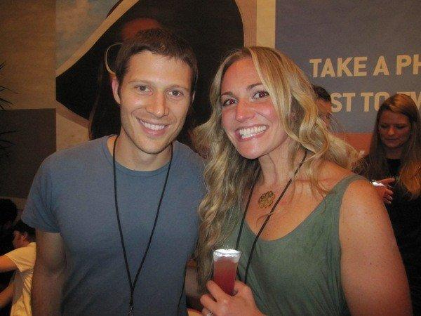 """""""Friday Night Lights"""" actor Zach Gilford (left) poses for a photo with a fan in the It's So Miami Oasis in the Hard Rock Hotel August 4, 2012."""