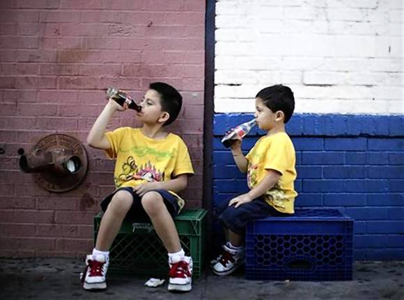 Two kids sip milk on a hot day
