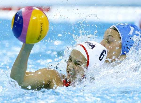 Maggie Steffens, left, of the United States, resists a challenge from Teresa Frassinetti of Italy during their women's water polo quarterfinal match Sunday.