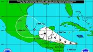 A slightly better organized Tropical Storm Ernesto moved toward Mexico on Sunday night,  still well below hurricane strength.