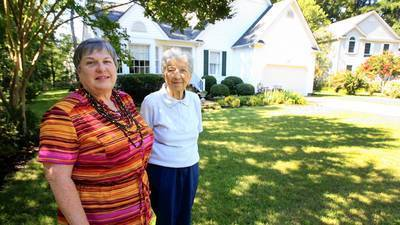 Master gardener Barb Foley, left, seeded the yard for her mother, Lee, with the tall fescue/hybrid bluegrass blend and it's done very nicely in this summer's hot weather.