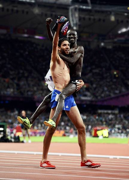 France's Mahiedine Mekhissi-Benabbad, who won silver, carries gold medallist Kenya's Ezekiel Kemboi as they celebrate after the men's 3000m steeplechase final.