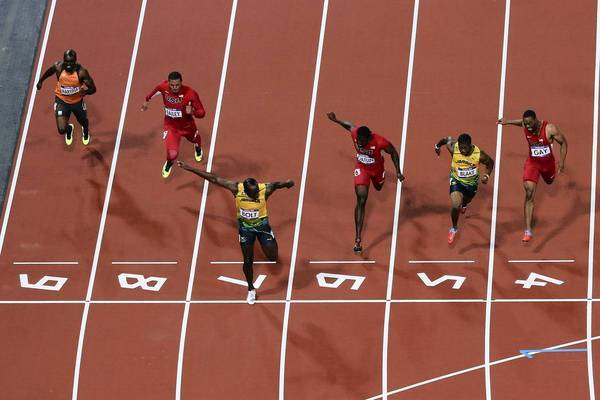 Usain Bolt of Jamaica crosses the finish line ahead of Ryan Bailey of the United States, Yohan Blake of Jamaica and Justin Gatlin of the United States to win the Men's 100m final.