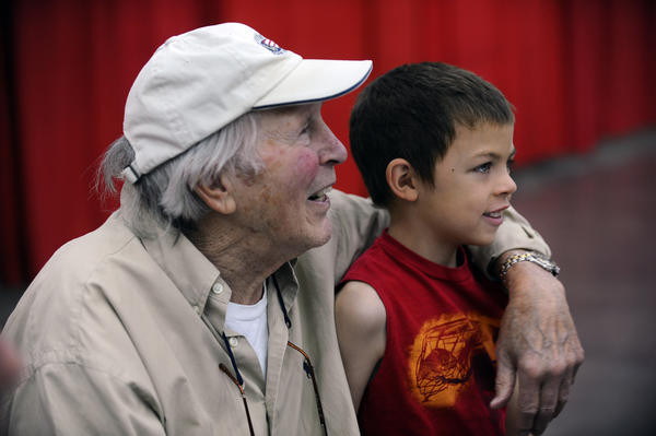 Baseball Hall-of-Famer and former Oriole Brooks Robinson, left, puts his arm around 6-year-old Brandon Conk, of Los Angeles, to pose for a picture.
