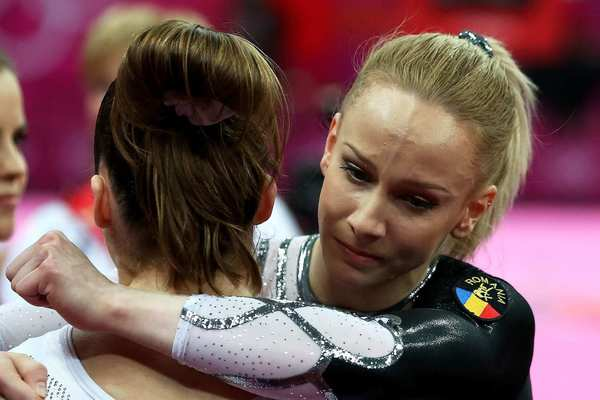 After winning the gold medal in the women's vault finals, Romanian gymnast Sandra Raluca Izbasa, right, hugs U.S. gymnast McKayla Maroney, who fell during a vault and slipped to silver.