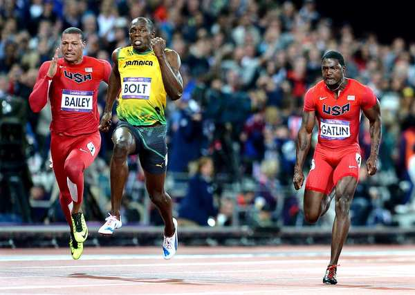 Jamaica's Usain Bolt pulls ahead of Team USA's Ryan Bailey, left, and Justin Gatlin to win gold in the 100 meters.