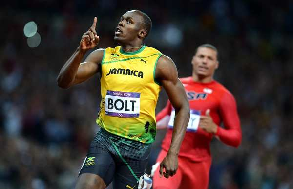 Jamaica's Usain Bolt celebrates after crossing the finish line in the 100-meter race.
