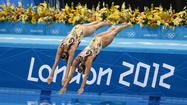 LONDON -- After the final dive, Christina Loukas smiled a perfunctory smile for the cameras and then, a few steps later along the pool deck, dropped her arms and buried her head into her coach's shoulder.