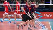 The stars of the volleyball court have brooms in their hands