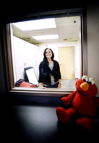 Sara Cohick looks through the one-way glass in an interviewing room. A Washington County Department of Social Services social worker, she was recognized in April by the Washington County State's Attorney's Office and Victim-Witness Unit, as well as the Washington County Board of Commissioners for her work with the young victim in the State vs. Charles Selby case.