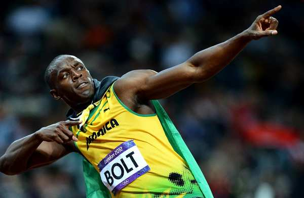 Jamaica's Usain Bolt strikes a pose after winning the gold medal in the 100 meters at the 2012 London Olympics.