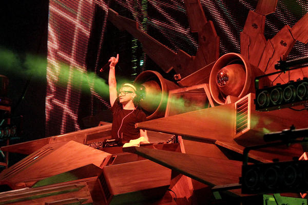 Skrillex (Sonny John Moore) points on stage while in his spaceship contraption.