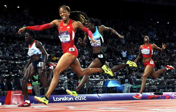 Team USA's Sanya Richards-Ross crosses the finish line to win the gold in the 400 meters at the 2012 London Olympics