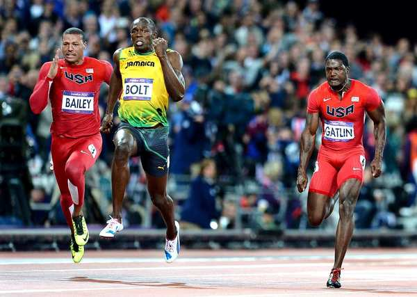 Jamaica's Usain Bolt, center, pulls ahead of Team USA's Ryan Bailey, left, and Justin Gatlin to win the gold medal in the 100 meters at the 2012 London Olympics.