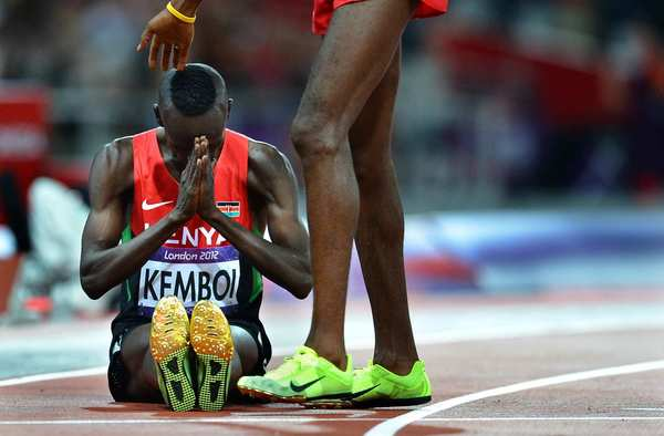 Kenya's Ezekiel Kemboi prays after winning the 3,000-meter steeplechase at the 2012 London Olympics. Kemboi also won the event in Athens, but came in seventh in Beijing.