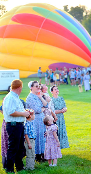 Spectators watch balloons take flight Friday in this file photo from the first day of the hot air balloon festival at Green Grove Gardens near Greencastle, Pa.