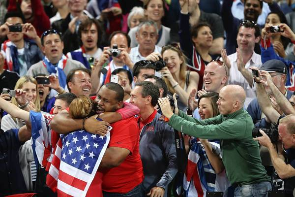 Sanya Richards-Ross celebrates winning gold in the women's 400m her husband, Giants cornerback Aaron Ross.