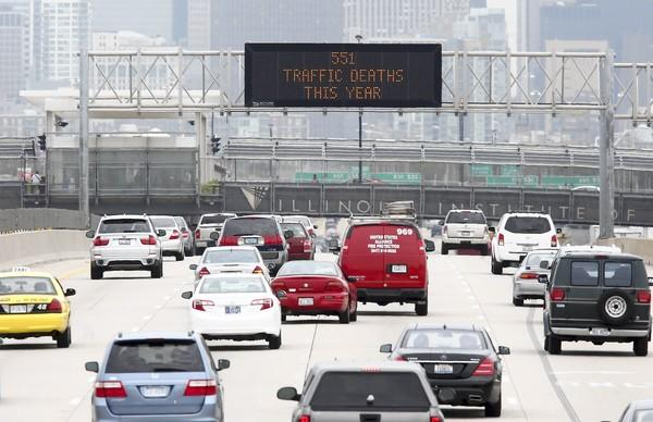 A sign on the Dan Ryan Expressway keeps a tally of this year's Illinois traffic deaths.