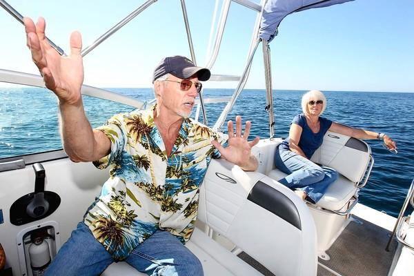 Philip Cruver -- on a boat with his partner, Debbie Johnson -- plans to build a farm for oysters and mussels about 4.5 miles off Long Beach. The farm would begin as a 100-acre underwater plot and could expand to 1,000 acres.