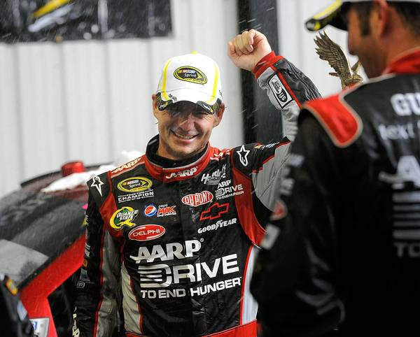 Jeff Gordon celebrates his victory in the rain-shortened Pennsylvania 400 at Pocono Raceway Sunday afternoon.