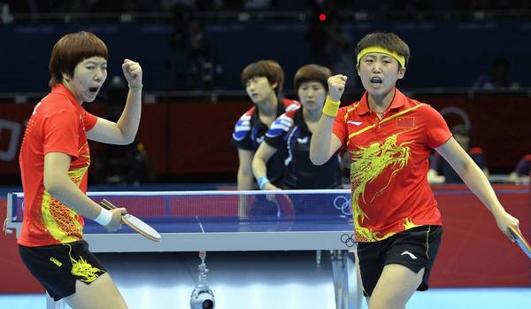 China's pair Li Xiaoxia, left, and Guo Yu, right, celebrates a vital point against South Korea's Seok Hajung and Dang Yeseo during a table tennis women's team semi-final match.