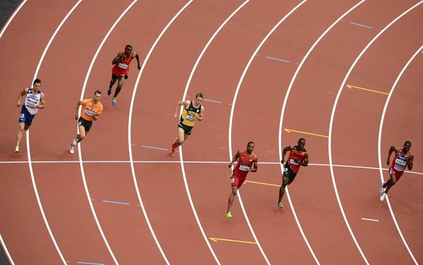 Czech Republic's Jakub Holusa, The Netherland's Robert Lathouwers, Equatorial Guinea's Benjamin Enzema, South Africa's Andre Olivier, U.S. runner Duane Solomon, Uganda's Julius Mutekanga, Brazil's Kleberson Davide and Haiti's Moise Joseph, compete in one of the Men's 800m heats.