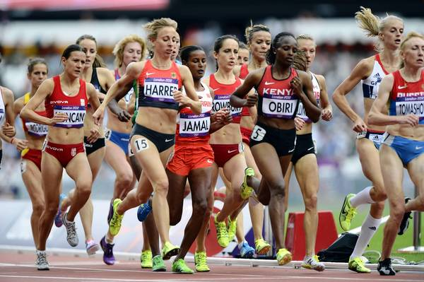 Shannon Rowbury (USA) runs in the middle of a pack in the women's 1500m heats during the 2012 London Olympic Games at Olympic Stadium.