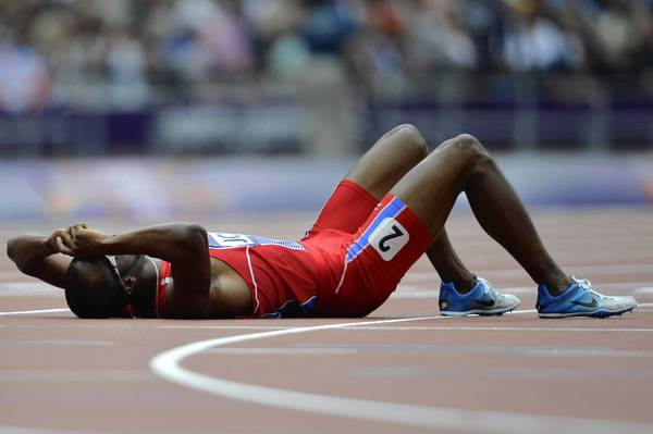 Haiti's Moise Joseph recovers on the track after competing in one of the Men's 800m heats.