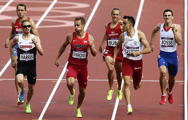 Geoffrey Harris, of Canada, and Nick Symmonds, of the United States, compete in the Men's 800m heat on Day 10 of the London 2012 Olympic Game