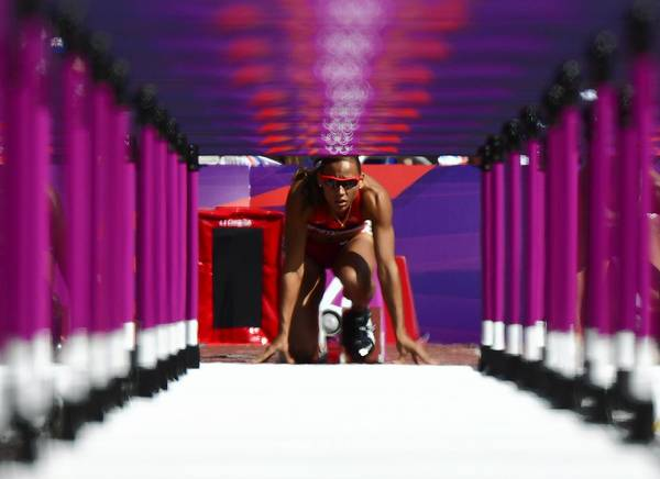 U.S. athlete LoLo Jones gets ready for the start of the women's 100m hurdles heats at the London 2012 Olympic Games.