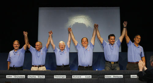 A proud lead team of John Grunsfield, Charles Elachi, Pete Theisinger, Richard Cook, Adam Steltzner and John Grotzinger, triumphantly raise their hands at JPL at the post landing press conference with the principals who successfully landed the Mars Rover Curiosity.