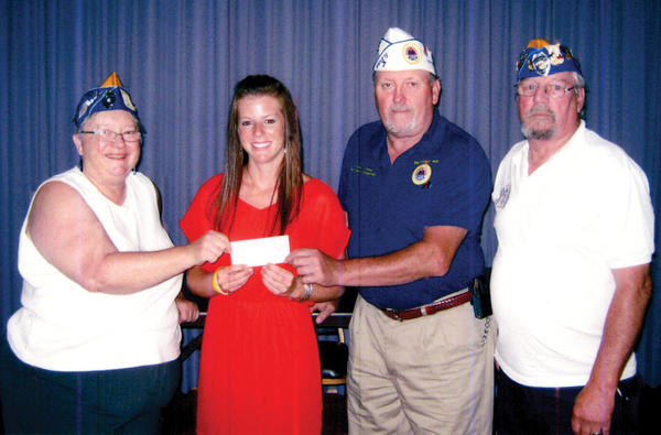 On July 7, a $500 nursing scholarship was given to Brittany Baker of Mount Airy, Md. From left are Cynthia Weedon of Sad Sacks, Baker, Mike Mahoney and Dwight Monnier.