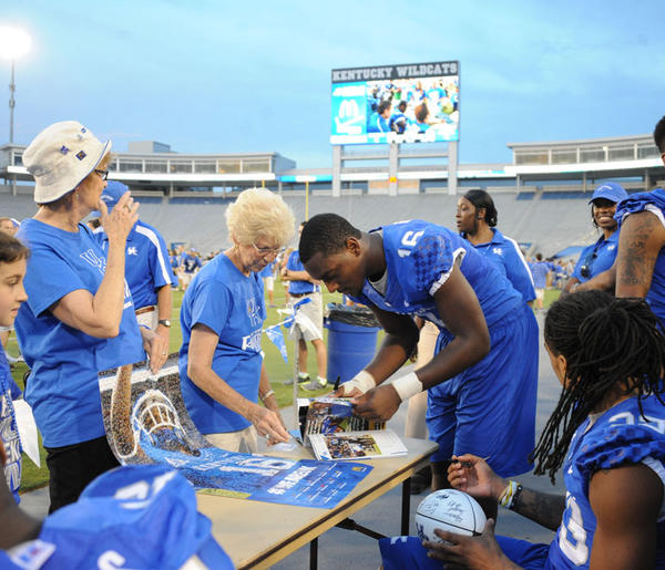 Kentucky receiver LaRod King signs autographs at UK's Fan Appreciation Day Saturday.