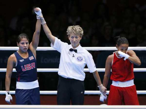 Marlen Esparza has her hand raised in victory after defeating Karlha Magliocco of Venezuela.