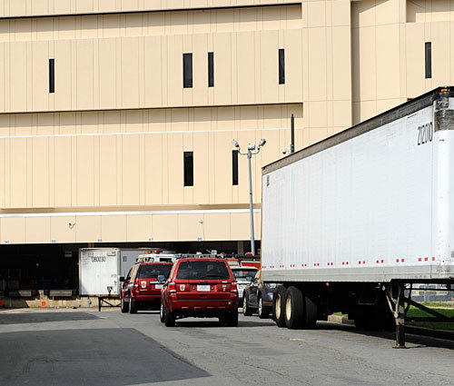 Baltimore City fire vehicles respond to the downtown delivery annex of the Post Office on Colvin Street, where workers were evacuated because of carbon monoxide fumes.