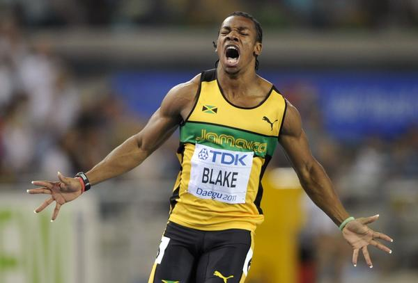 Yohan Blake celebrating wins men's 100 meters final at the IAAF 2011 World Championships in Daegu. Blake took the silver medal in the 100 meters final in the 2012 Olympics, coming behind training partner Usain Bolt.