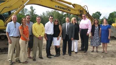 Staff from Dermatology Associates of Northern Michigan, and from businesses involved in its new office building project, gather Tuesday at the project site at U.S. 31 and Lake Grove Road for a groundbreaking ceremony.