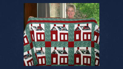 "Cathy Bilotto's quilt titled ""Schoolhouse,"" will be exhibited at the Alexander Walker reunion Sunday."