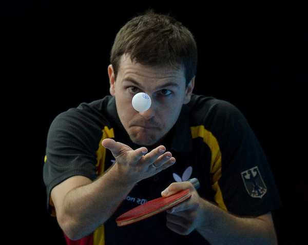 Germany's Timo Boll looks like a magician levitating a pingpong ball, but he is just serving in a men's team table tennis semifinal match against China. The German team lost, 3-1.