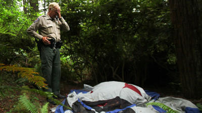 ARCATA, CA - June 20 2012:  Arcata police park ranger Dave Miller surveys trash and camping equipment left by homeless in the Arcata Community Forest June 20 2012 in Arcata. Miller regularly patrols the redwood forest to rout camper who damage the fragile ecosystem leaving waste and trash. (Brian van der Brug/Los Angeles Times)