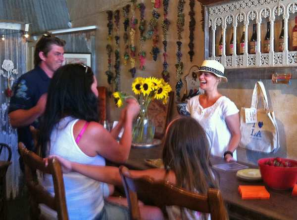 Casa Dumetz winemaker Sonja Magdevski shares a laugh with visitors inside Casa Dumetz's cheerful Babi's Tasting Room. Magdevski spends her weekends in Los Alamos running the tasting room, as does her fiance, Emilio Estevez, when he's not working. The pair are supporters of the growing food and wine scene in the town.