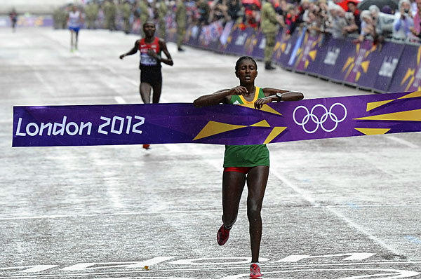 Ethiopia's Tiki Gelana breaks the finish line first to win the women's marathon on Aug. 5 at the London Games. Despite falling early in the race, Gelana finished with an Olympic record of 2:23:07.