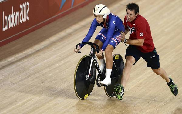 U.S. cyclist Sarah Hammer gets a push from her coach before competing in the London 2012 Olympic Games Women's Omnium flying lap 250m time trial cycling event at the Velodrome in the Olympic Park in East London
