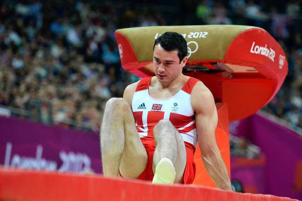Britain's gymnast Kristian Thomas reacts after falling during the men's vault final of the artistic gymnastics event of the London Olympic Games.